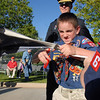 Cub Scout James Hall, 9, makes the final cut to separate the stars from a flag during the flag retirement ceremony at North Metro Fire station 61 on Tuesday.<br /> June 14, 2011<br /> staff photo/David R. Jennings