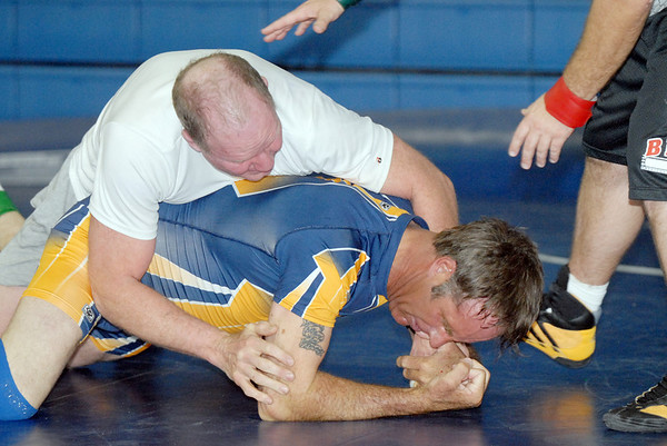Chas Daker, 60, left, wrestles Roy Gollobith, 48, during the Old Timers Wrestling tournament on Saturday at Broomfield High School.<br /> <br /> <br /> March 13, 2010<br /> Staff photo/David R. Jennings