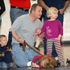 Harold Trudeau watches matches with his children Ian, 2, right, Ivy, 2, and Lily, 4, during the Old Timers Wrestling tournament on Saturday at Broomfield High School.<br /> <br /> <br /> March 13, 2010<br /> Staff photo/David R. Jennings