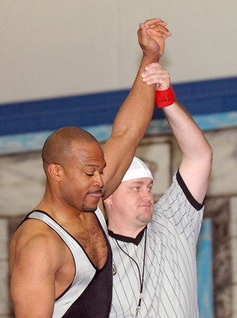 Dewaine Jones, 42, has his arm raised by ref Brian LaFave after Jones'  won the match against Steve Lontine, 38, during the Old Timers Wrestling tournament on Saturday at Broomfield High School.<br /> <br /> <br /> March 13, 2010<br /> Staff photo/David R. Jennings