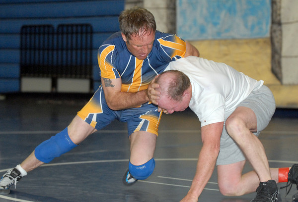Roy Gollobith, 48, left, wrestles Chas Daker, 60, during the Old Timers Wrestling tournament on Saturday at Broomfield High School.<br /> <br /> <br /> March 13, 2010<br /> Staff photo/David R. Jennings
