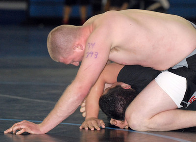 George Ashauer, 27, top, wrestles Eric Vasquez, 18, during the Old Timers Wrestling tournament on Saturday at Broomfield High School.   March 13, 2010 Staff photo/David R. Jennings
