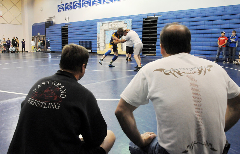 Fans watch a wrestling match in the Old Timers Wrestling tournament on Saturday at Broomfield High School.<br /> <br /> <br /> March 13, 2010<br /> Staff photo/David R. Jennings