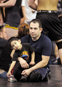 Jacob Rosales, 35, watches matches with his son Samuel, 3,  at the Old Timers Wrestling tournament on Saturday at Broomfield High School.   March 13, 2010 Staff photo/David R. Jennings