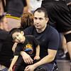 Jacob Rosales, 35, watches matches with his son Samuel, 3,  at the Old Timers Wrestling tournament on Saturday at Broomfield High School.<br /> <br /> <br /> March 13, 2010<br /> Staff photo/David R. Jennings