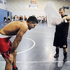 Nate Ramirez, 35, is fanned by Steve Lontine during a break in the bout at the Old Timers Wrestling tournament on Saturday at Broomfield High School.<br /> <br /> <br /> March 13, 2010<br /> Staff photo/David R. Jennings