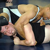 Dewaine Jones, 42, top, wrestles Steve Lontine, 38, during the Old Timers Wrestling tournament on Saturday at Broomfield High School.<br /> <br /> <br /> March 13, 2010<br /> Staff photo/David R. Jennings