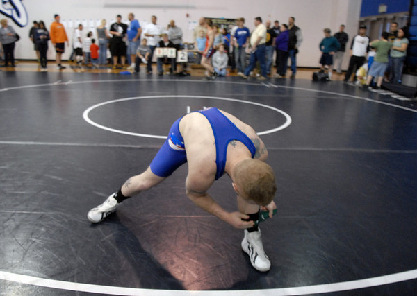 A wrestler prepares for his match at the Old Timers Wrestling tournament on Saturday at Broomfield High School.<br /> <br /> <br /> March 13, 2010<br /> Staff photo/David R. Jennings