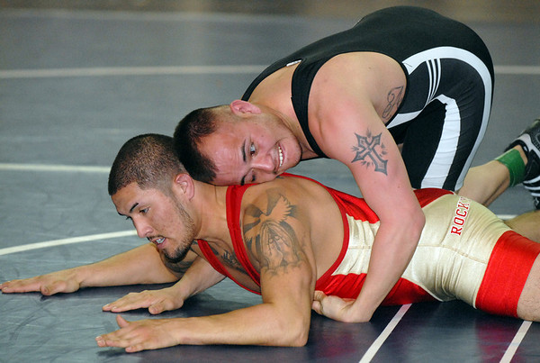 Jose Fuentes, 27, wrestles his friend Jeron Aragon, 22, in red,  during the Old Timers Wrestling tournament on Saturday at Broomfield High School.<br /> <br /> <br /> March 13, 2010<br /> Staff photo/David R. Jennings