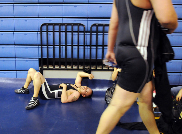 Jose Fuentes, 27, rests after a match in the Old Timers Wrestling tournament on Saturday at Broomfield High School.<br /> <br /> <br /> March 13, 2010<br /> Staff photo/David R. Jennings