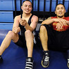 Jose Fuentes, 27, left, and Jeron Aragon, 22, take a rest after wrestling each other in the Old Timers Wrestling tournament on Saturday at Broomfield High School.<br /> <br /> <br /> March 13, 2010<br /> Staff photo/David R. Jennings