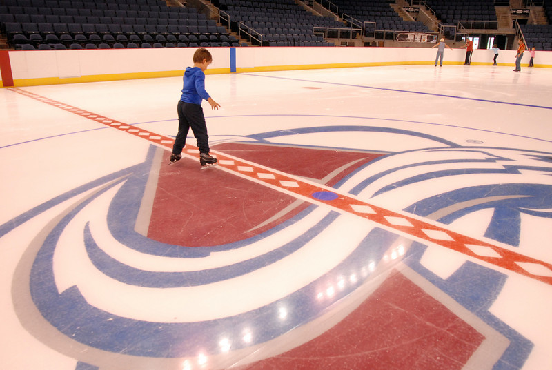 Parker Zarecki, 6, checks out center ice during Wednesday's free ice skating at the 1stBank Center.<br /> <br /> September 15, 2010<br /> staff photo/David R. Jennings