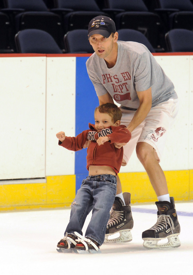 Tommy Ruffles, 4, skates with his father Tom while skating during Wednesday's free ice skating at the 1stBank Center.<br /> <br /> September 15, 2010<br /> staff photo/David R. Jennings