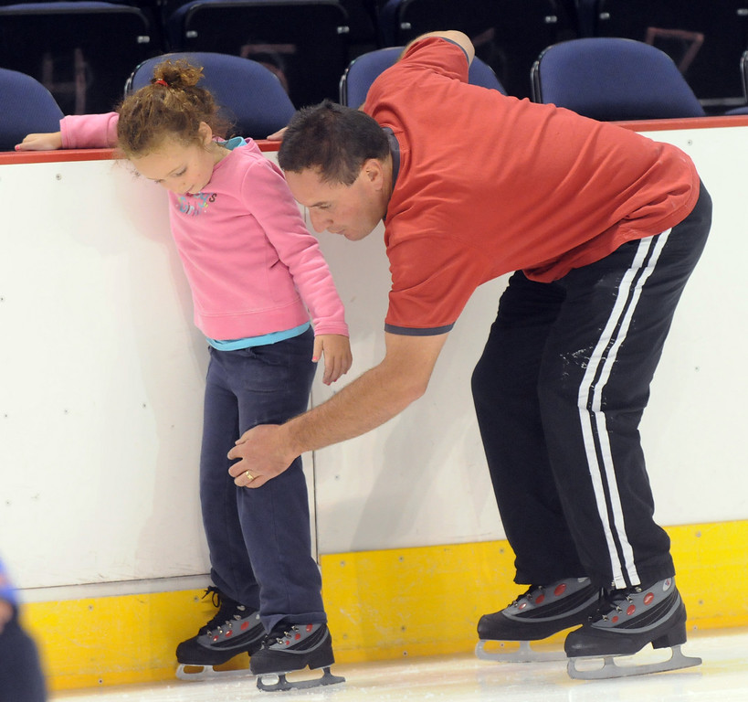 James Zarecki helps his daughter Sierra, 5, during Wednesday's free ice skating at the 1stBank Center.<br /> <br /> September 15, 2010<br /> staff photo/David R. Jennings