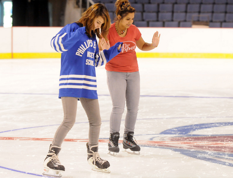 Brittany Bazykowski, 13, left, wearing her father's hockey shirt, and Dani Schwartz, 14, skate at center ice during Wednesday's free ice skating at the 1stBank Center. Bazykowski said she'd like to play hockey in the future.<br /> <br /> September 15, 2010<br /> staff photo/David R. Jennings