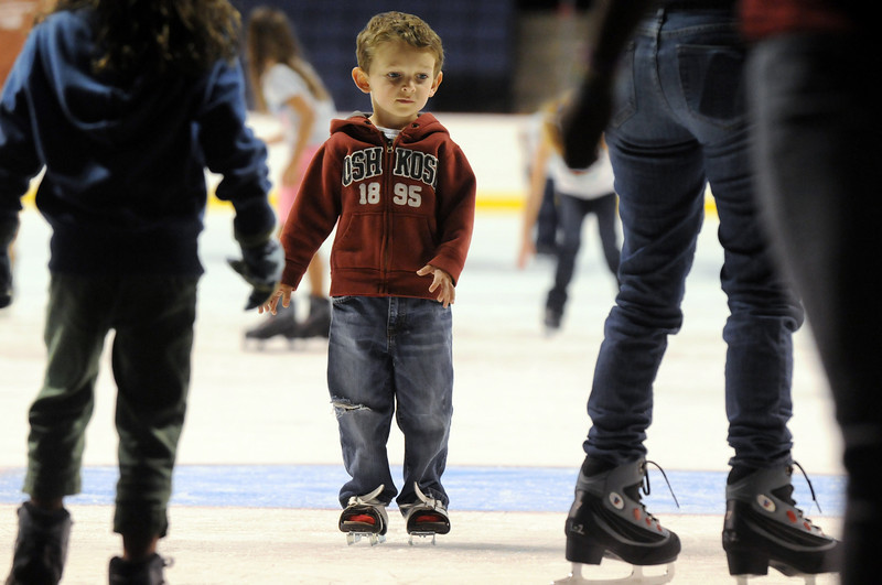Tommy Ruffles, 4, skates slowly to the edge of the rink on his double bladed skated during Wednesday's free ice skating at the 1stBank Center.<br /> <br /> September 15, 2010<br /> staff photo/David R. Jennings