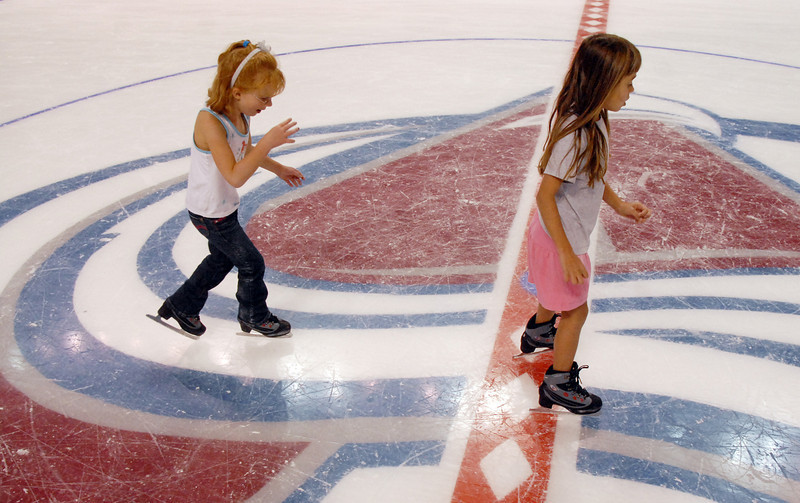 Laney Bowers, 5, left follows her friend Paige Rodgers, 7, while skating during Wednesday's free ice skating at the 1stBank Center.<br /> <br /> September 15, 2010<br /> staff photo/David R. Jennings