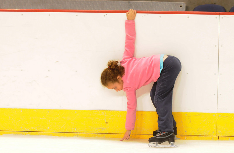 Sierra Zarecki, 5, checks the ice on the edge of the rink during Wednesday's free ice skating at the 1stBank Center.<br /> <br /> September 15, 2010<br /> staff photo/David R. Jennings
