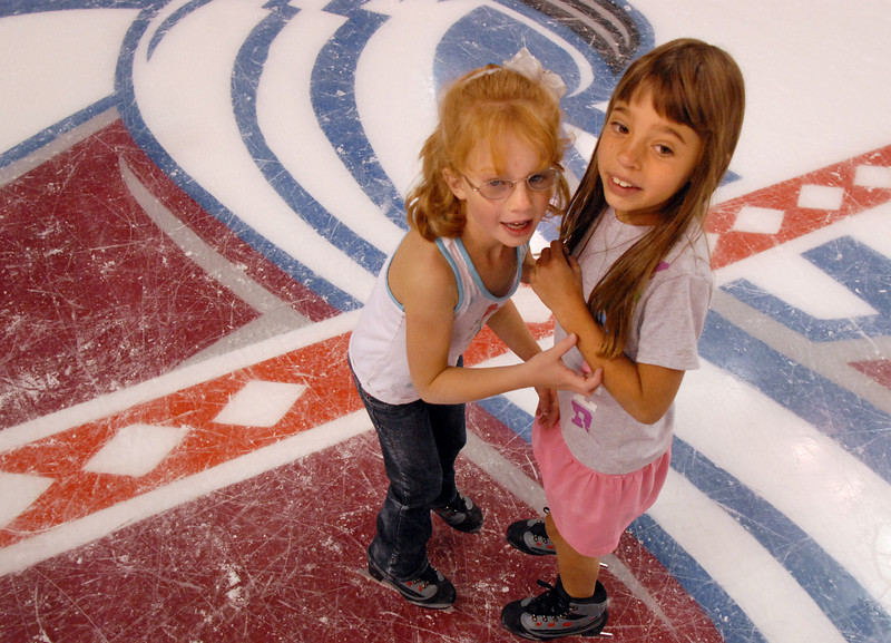 Laney Bowers, 5, left, and Paige Rodgers, 7, skate at center ice during Wednesday's free ice skating at the 1stBank Center.<br /> <br /> September 15, 2010<br /> staff photo/David R. Jennings