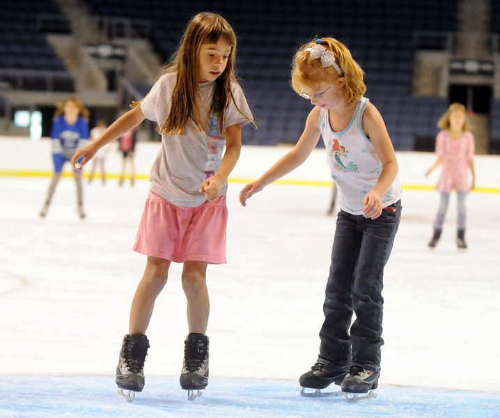 Paige Rodgers, 7, left, and Laney Bowers, 5, skate during Wednesday's free ice skating at the 1stBank Center.<br /> <br /> September 15, 2010<br /> staff photo/David R. Jennings