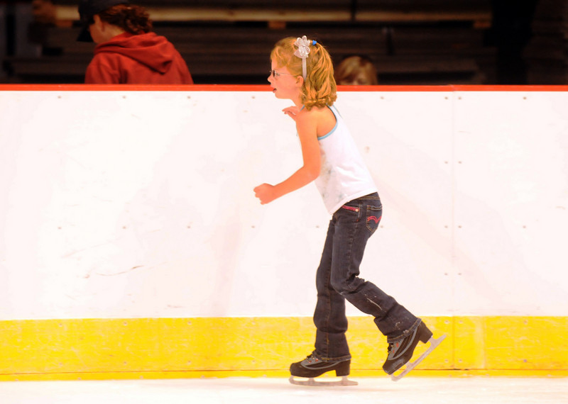 Laney Bowers, 5, skates on the edge of the rink during Wednesday's free ice skating at the 1stBank Center.<br /> <br /> September 15, 2010<br /> staff photo/David R. Jennings