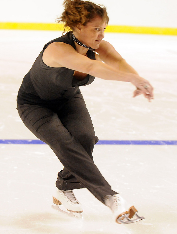 Diane Kingsbeck took advantage of the free ice to practice parts of her routine for  an amateur competition during Wednesday's free ice skating at the 1stBank Center.<br /> <br /> September 15, 2010<br /> staff photo/David R. Jennings