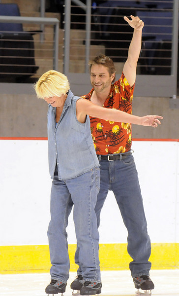 Shelly and David Jasperson try a little routine during Wednesday's free ice skating at the 1stBank Center.<br /> <br /> September 15, 2010<br /> staff photo/David R. Jennings