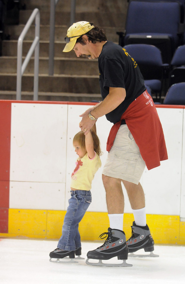 Chris Disch skates with his daughter Keira, 3, during Wednesday's free ice skating at the 1stBank Center.<br /> <br /> September 15, 2010<br /> staff photo/David R. Jennings