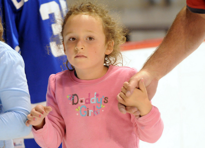 Sierra Zarecki, 5, holds her father James' hand while skating during Wednesday's free ice skating at the 1stBank Center.<br /> <br /> September 15, 2010<br /> staff photo/David R. Jennings