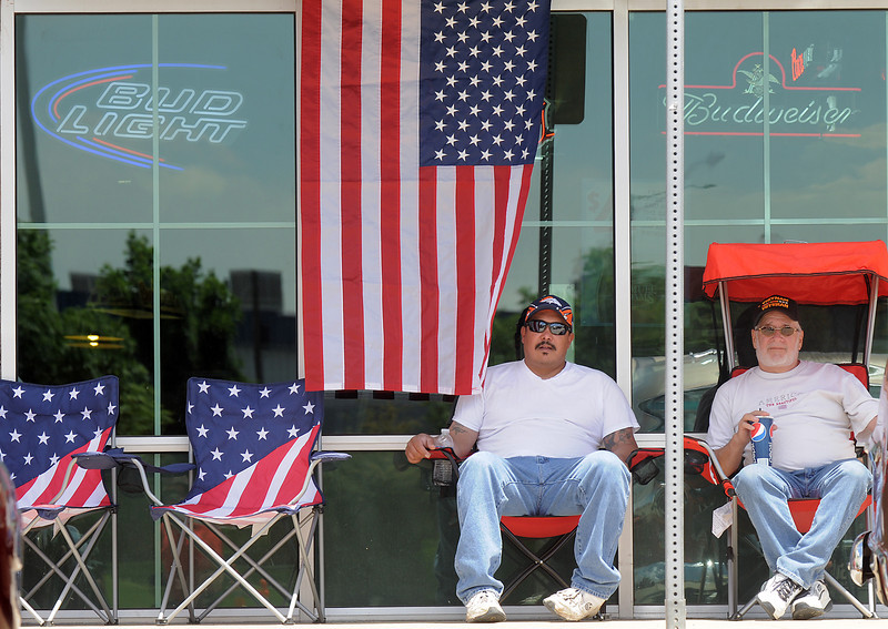 Ryan and Mike Castro keep watch over their car  in the One Soldier's Dream car show fundraiser for at Bumpers restaurant on Saturday.<br /> <br /> June 18, 2011<br /> staff photo/David R. Jennings