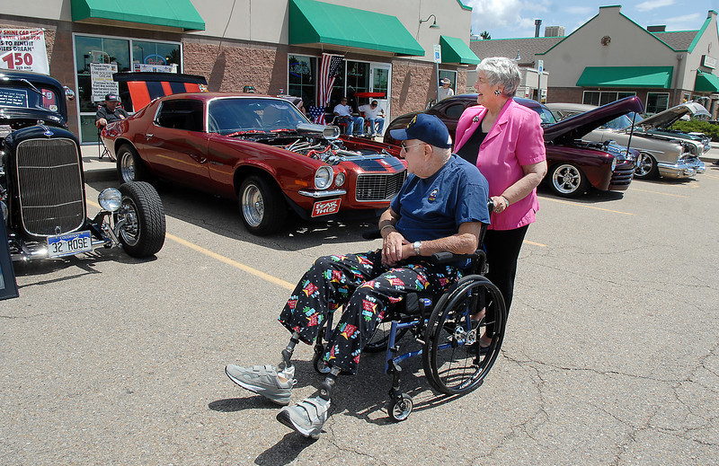 Tom And Kay Ryan stroll along cars in the One Soldier's Dream car show fundraiser for at Bumpers restaurant on Saturday.<br /> June 18, 2011<br /> staff photo/David R. Jennings