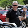 Mark Karpowich and his son Ausborne, 1, look at cars in the One Soldier's Dream car show fundraiser for at Bumpers restaurant on Saturday.<br /> June 18, 2011<br /> staff photo/David R. Jennings