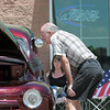 Cecil Hicks looks at cars in the One Soldier's Dream car show fundraiser for at Bumpers restaurant on Saturday.<br /> June 18, 2011<br /> staff photo/David R. Jennings