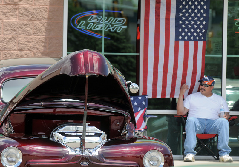 Ryan Castro sits in the shade while watching his car in the One Soldier's Dream car show fundraiser for at Bumpers restaurant on Saturday.<br /> <br /> June 18, 2011<br /> staff photo/David R. Jennings