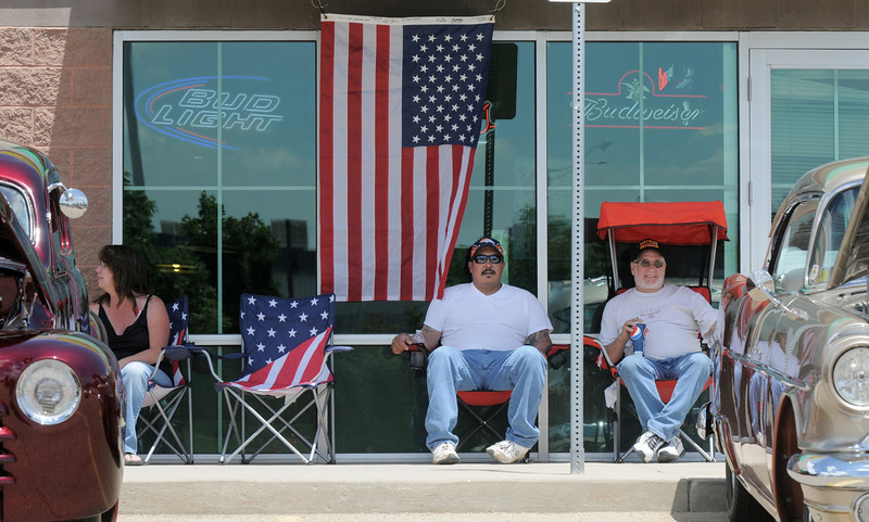 Ryan and Mike Castro keep watch over their car  in the One Soldier's Dream car show fundraiser for at Bumpers restaurant on Saturday.<br /> June 18, 2011<br /> staff photo/David R. Jennings