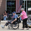 Tom And Kay Ryan stroll along cars in the One Soldier's Dream car show fundraiser for at Bumpers restaurant on Saturday.<br /> <br /> June 18, 2011<br /> staff photo/David R. Jennings
