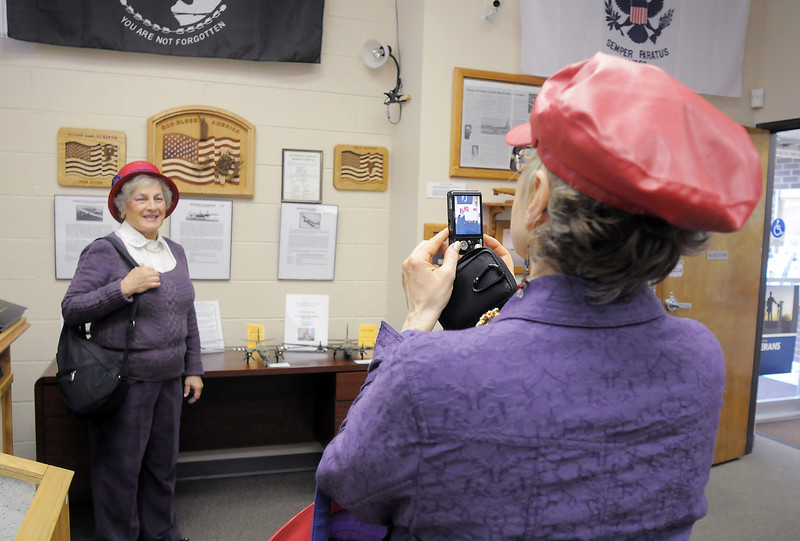 Joyce Fowler, right, takes a picture of Gloria Carrillo, both Red Hat Society members of the Scarlet Bells of Colorado, during the open house at the Broomfield Veterans Memorial Museum on Saturday.<br /> January 14, 2012<br /> staff photo/ David R. Jennings