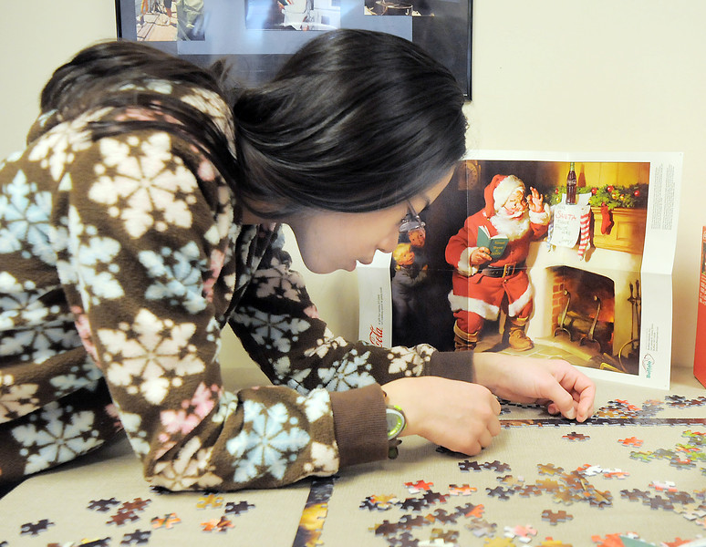 Hulstrom Options School student, Elise Ng, 12, works on putting together a jigsaw puzzle during the open house at the Broomfield Veterans Memorial Museum on Saturday.<br /> January 14, 2012<br /> staff photo/ David R. Jennings