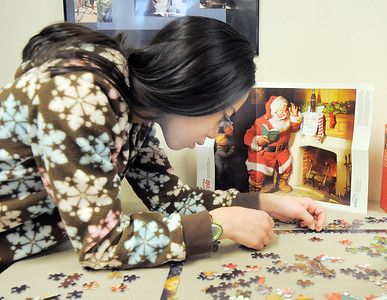 Hulstrom Options School student, Elise Ng, 12, works on putting together a jigsaw puzzle during the open house at the Broomfield Veterans Memorial Museum on Saturday. January 14, 2012 staff photo/ David R. Jennings