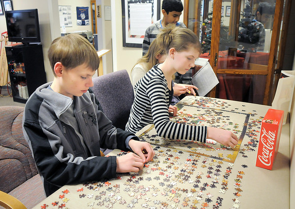 Hulstrom Options School students Elizabeth Platt, 12, right, and her brother William, 13, work on a jigsaw puzzle during the open house at the Broomfield Veterans Memorial Museum on Saturday.<br /> January 14, 2012<br /> staff photo/ David R. Jennings