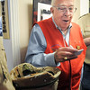 Bob Davenport on of the founders of the Broomfield Veterans Memorial Museum reads out the name of one of the winners of a Noodles and Company gift card during the open house at the Broomfield Veterans Memorial Museum on Saturday.<br /> January 14, 2012<br /> staff photo/ David R. Jennings