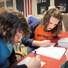Hulstrom Options School students Jeni Robinson, 12, left, and Madison Allen, 13, address holiday card envelopes for soldiers and veterans during the open house at the Broomfield Veterans Memorial Museum on Saturday.<br /> January 14, 2012<br /> staff photo/ David R. Jennings