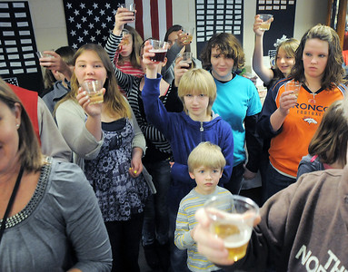 Students from Hulstrom Options School join in the toast with sparkling grape juice to celebrate the new year for the Broomfield Veterans Memorial Museum during the open house on Saturday. January 14, 2012 staff photo/ David R. Jennings