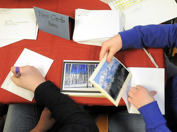Hulstrom Options School students Jeni Robinson, 12, left, and Delaney Campbell, 12, address and place holiday cards for soldeirs and veterans during the open house at the Broomfield Veterans Memorial Museum on Saturday.<br /> January 14, 2012<br /> staff photo/ David R. Jennings