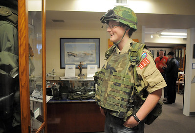 Boy Scout Connor Pearson, 15, with Troop 511, tries on some Vietman era gear during the open house at the Broomfield Veterans Memorial Museum on Saturday. January 14, 2012 staff photo/ David R. Jennings