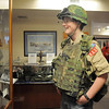 Boy Scout Connor Pearson, 15, with Troop 511, tries on some Vietman era gear during the open house at the Broomfield Veterans Memorial Museum on Saturday.<br /> January 14, 2012<br /> staff photo/ David R. Jennings