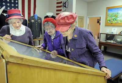 Red Hat Society members Gloria Carrillo, left, Evelyn Wight and Joyce Fowler of the Scarlet Bells of Colorado chapter look at displays during the open house at the Broomfield Veterans Memorial Museum on Saturday. January 14, 2012 staff photo/ David R. Jennings