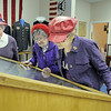 Red Hat Society members Gloria Carrillo, left, Evelyn Wight and Joyce Fowler of the Scarlet Bells of Colorado chapter look at displays during the open house at the Broomfield Veterans Memorial Museum on Saturday.<br /> January 14, 2012<br /> staff photo/ David R. Jennings
