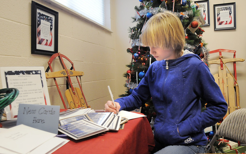 Delaney Campbell, 12, Hulstrom Options School student, addresses envelopes for the last of the 3,000 cards sent to soldiers and veterans during the open house at the Broomfield Veterans Memorial Museum on Saturday.<br /> January 14, 2012<br /> staff photo/ David R. Jennings