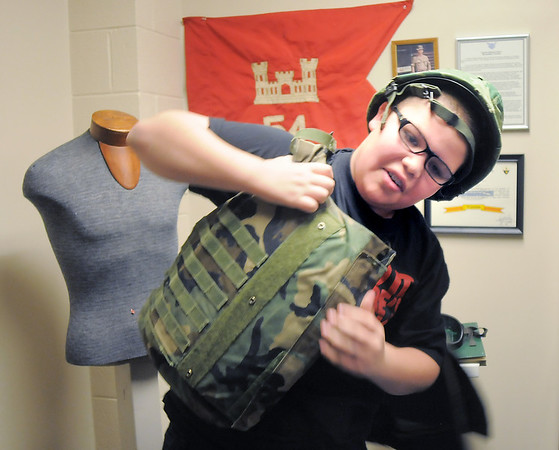 Hulstrom Options School student Antonio Teran, 12, tries on a Vetnam era flak jacket during the open house at the Broomfield Veterans Memorial Museum on Saturday.<br /> January 14, 2012<br /> staff photo/ David R. Jennings